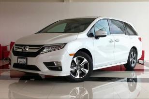Honda Odyssey 5pts.Touring, TA,a/ac., GPS, DVD, f. led, RA-18 - GocarCredit